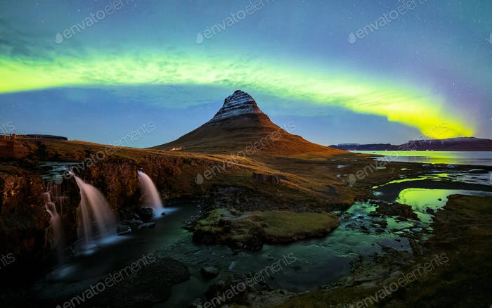 Northern light (Aurora Borealis) over Kirkjufell mountain in iceland
