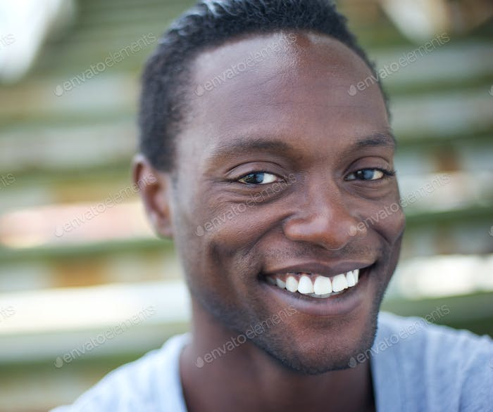 Portrait of a happy africa american man smiling outdoors