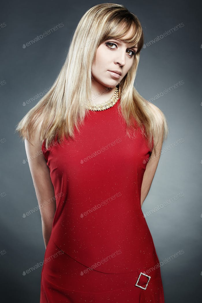 Portrait of the blonde woman in a red dress