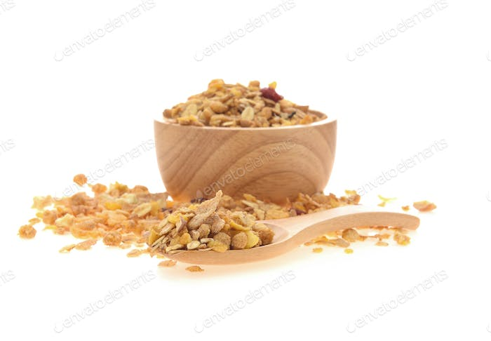 Cereal in wooden spoon and wood bowl on white background.