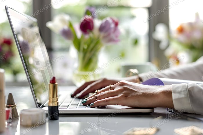 Woman Using Laptop Surfing Online Shop