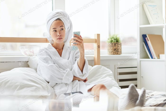 Asian Woman Relaxing in Morning