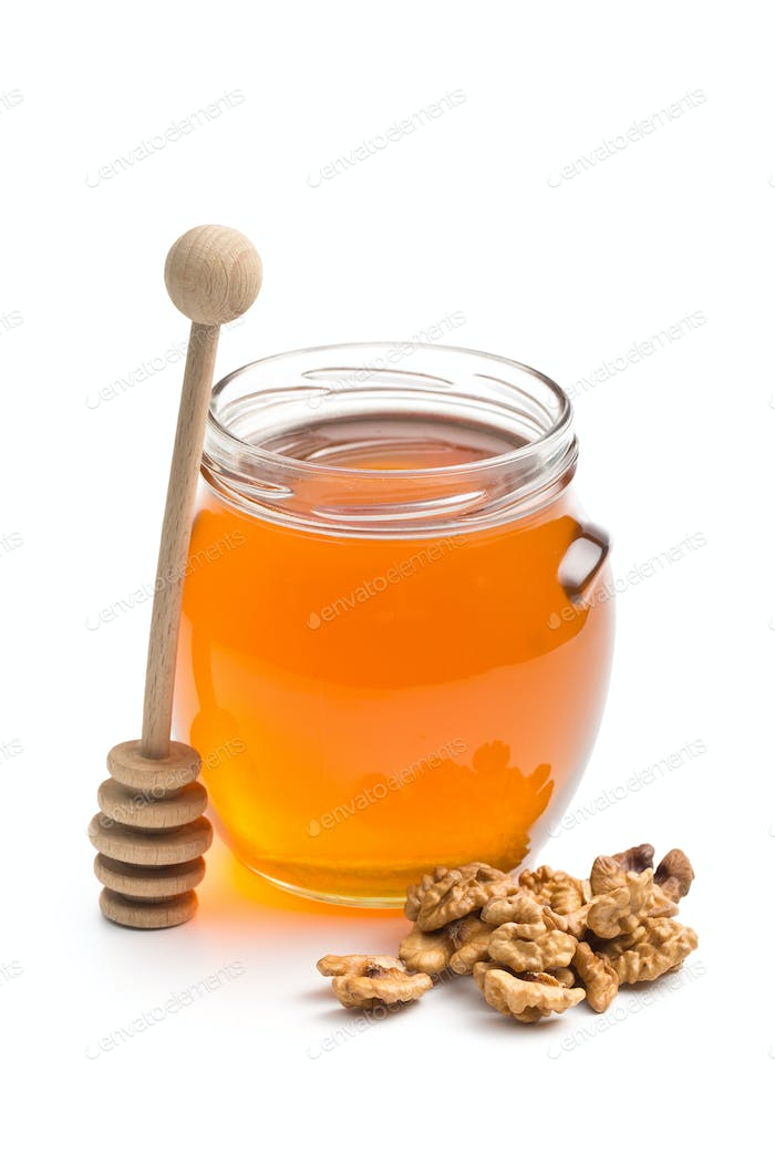 honey in a jar and walnuts