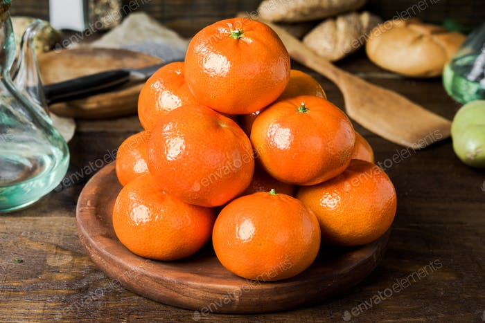 group of tangerines arranged in a pyramid on classic rustic wood