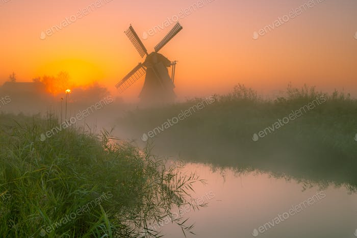Dutch Windmill in a wet polder