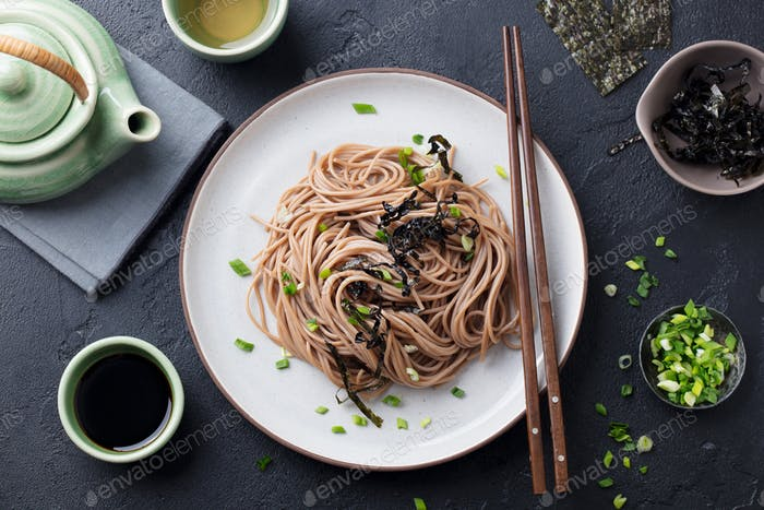 Soba Noodles with Sauce and Garnishes. Japanese Food. Top View. Black Background.