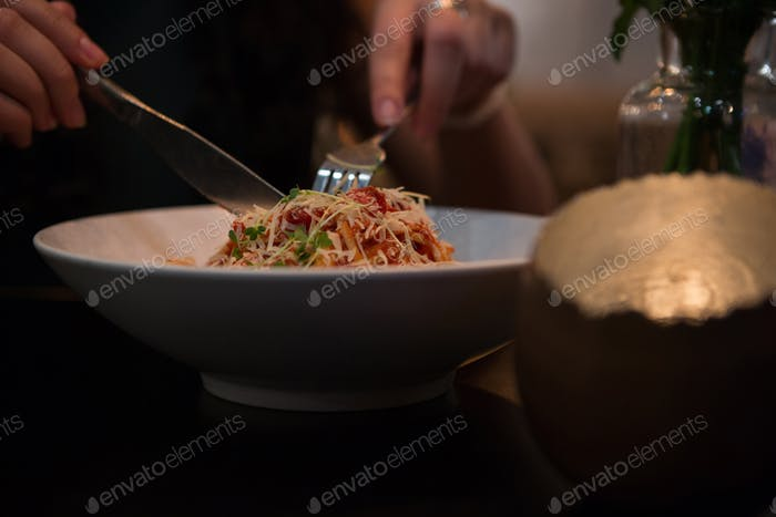 Mid section of person having food