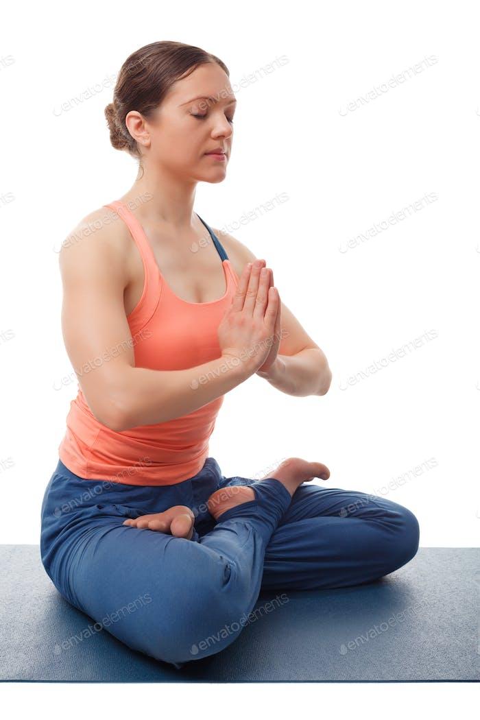 Beautiful sporty fit yogini woman meditates in Padmasana asana l