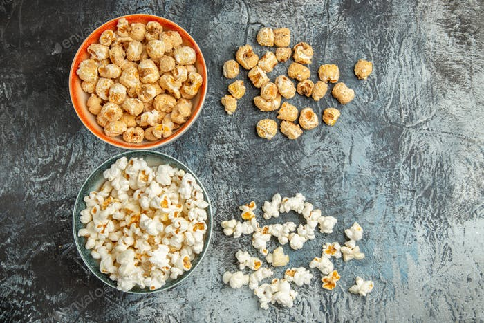 top view fresh popcorn sweet and salty snacks on light background cinema movie snack cips