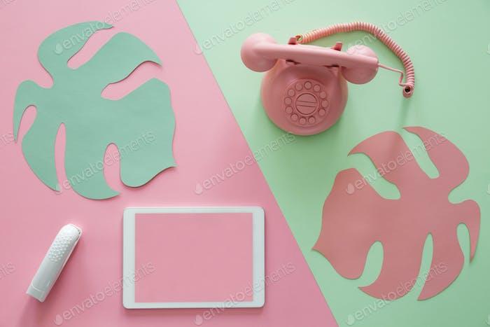 Tablet on pink background