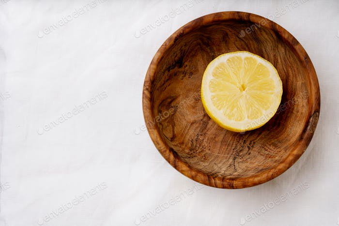 Lemons with wooden Juicer