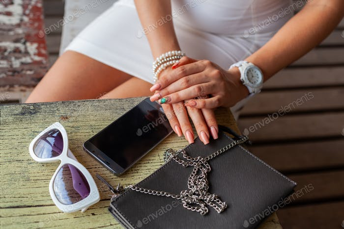 stylish woman hands using smartphone