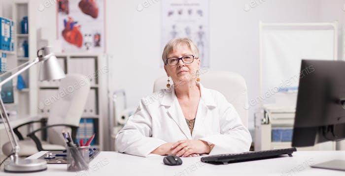 Elderly aged woman doctor