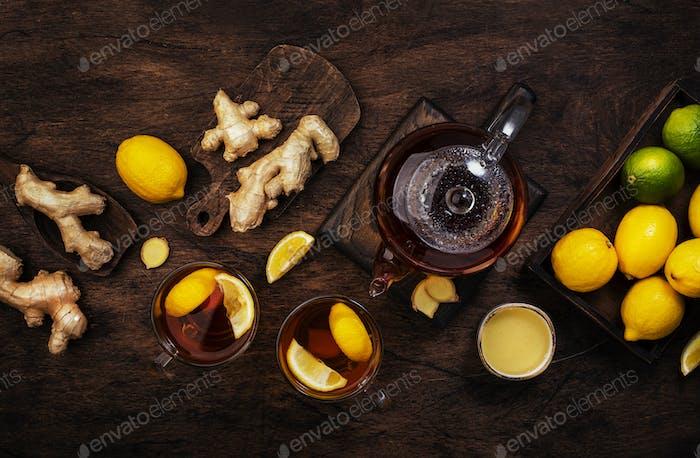Healing black herbal tea with ginger, honey, lemon