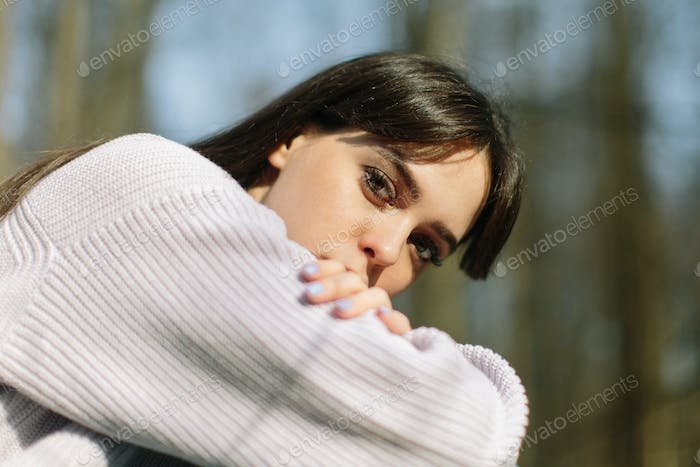 young attractive brunette woman alone in wild forest