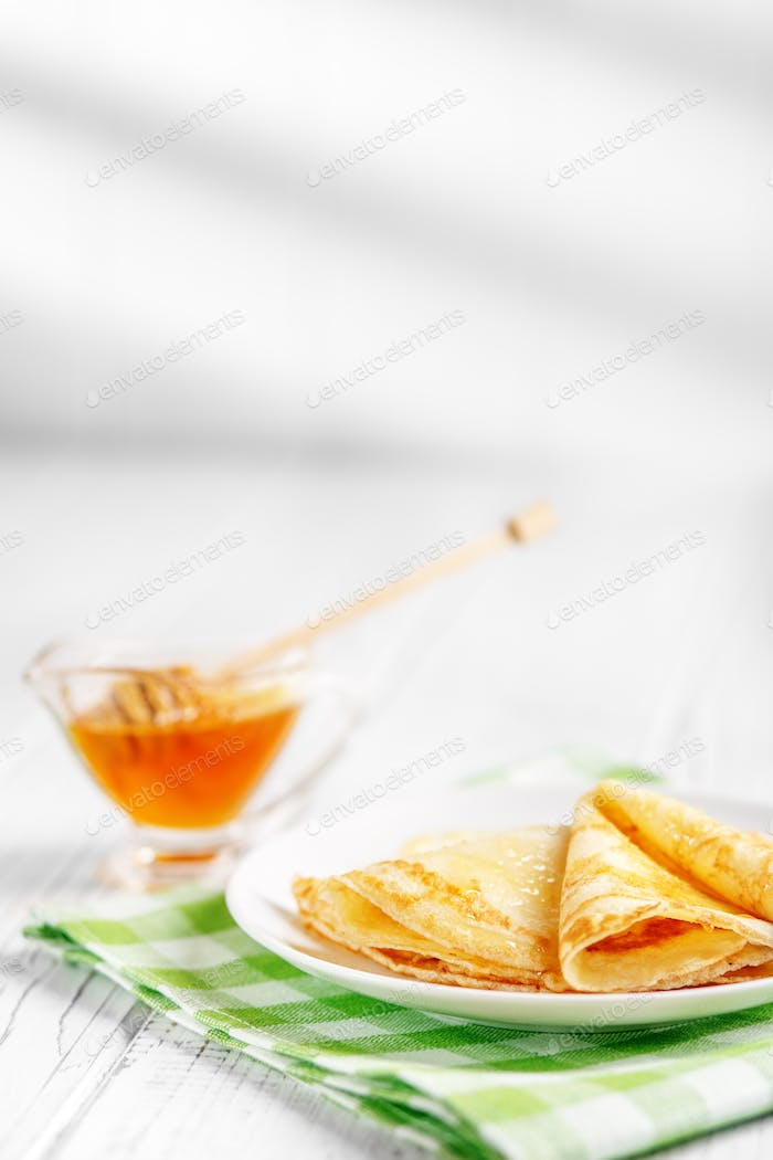 Sweet delicious pancakes with honey. Breakfast for children. The