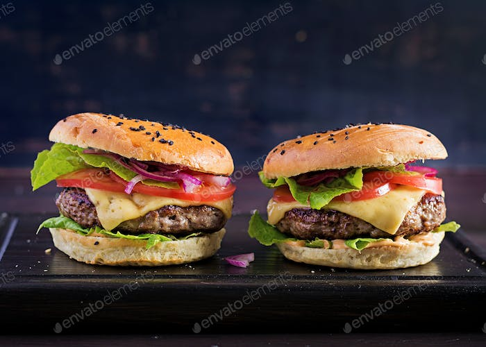 Big sandwich - hamburger burger with beef,  tomato,  cheese and lettuce.
