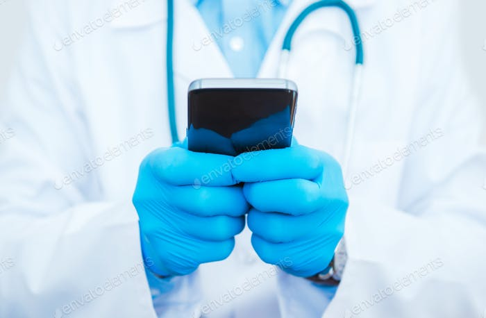 Doctor Playing Smartphone