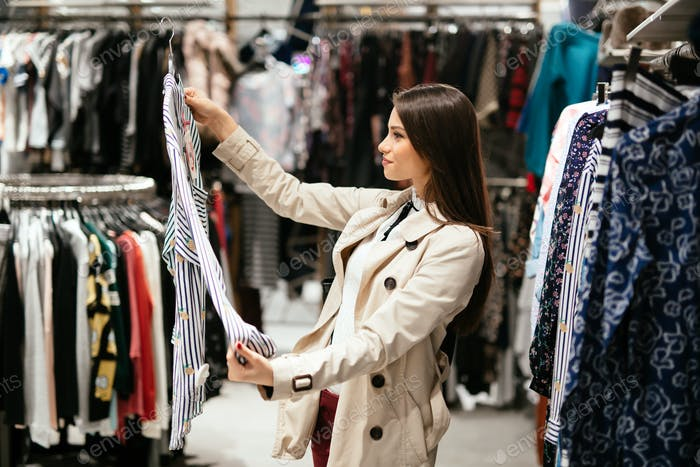 Beautiful woman buying clothes