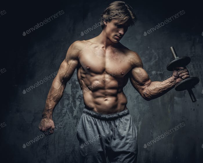 Shirtless bodybuilder holding dumbell.