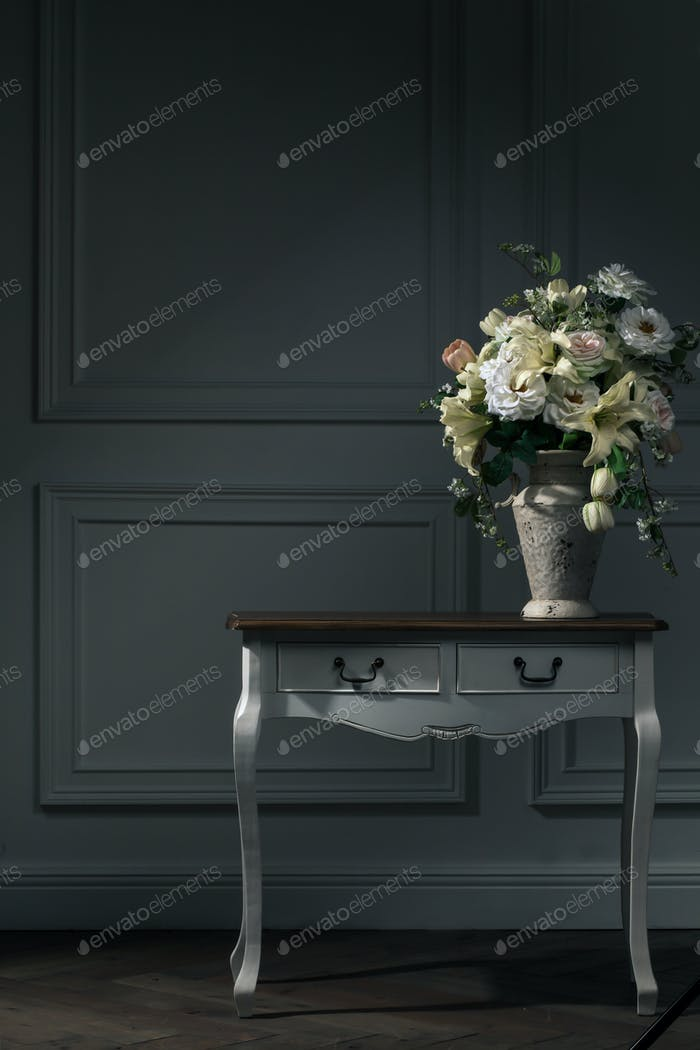dark interior, table, vase with flowers