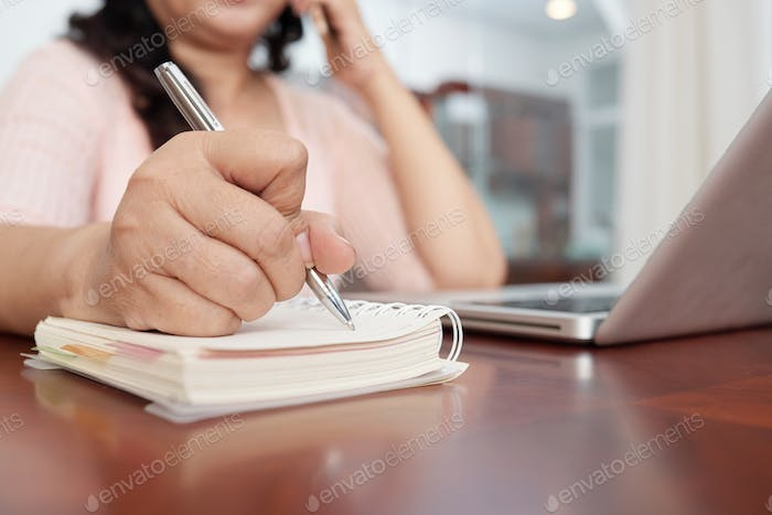 Woman Writing Down Notes