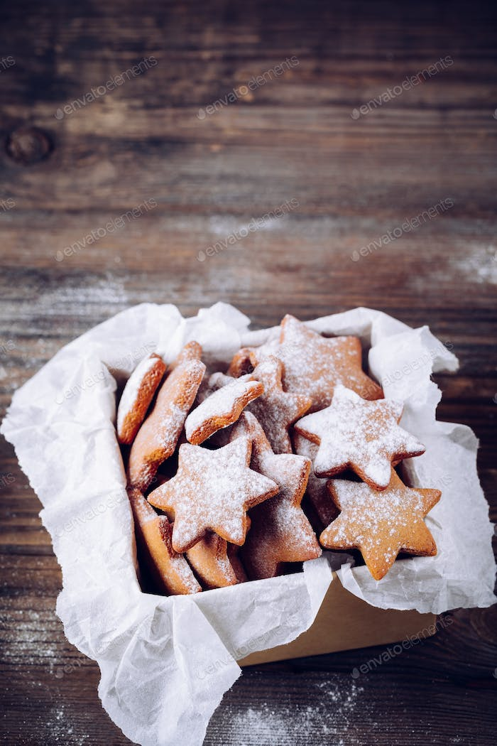 Homemade baked Christmas gingerbread cookies with icing sugar in the box