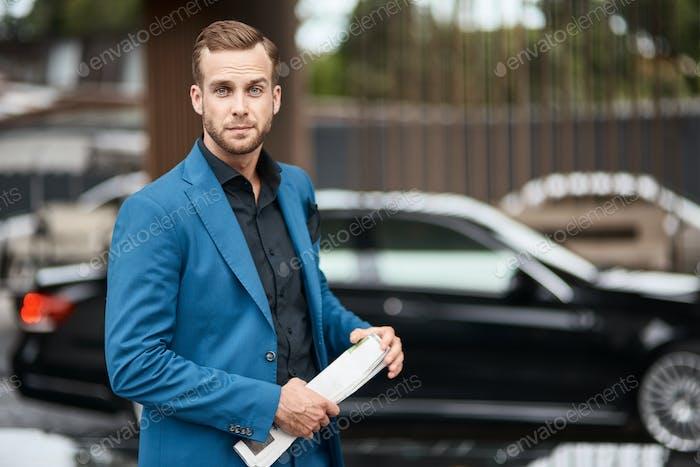 Handsome self assertive businessman standing outdoors