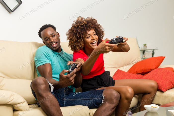 Black African American couple having fun playing video games