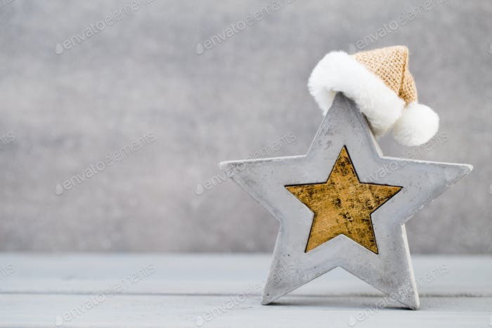 Christmas star and santa hat. Greeting card.