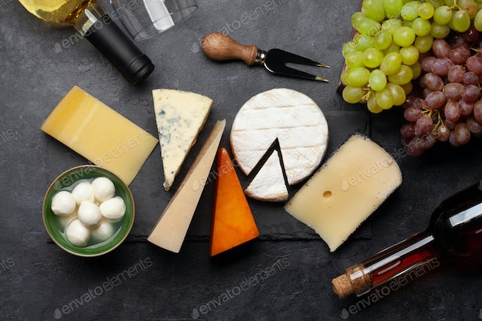 Various cheese, grapes and white wine