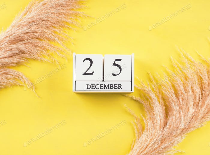 Calendar December,25 date on yellow background