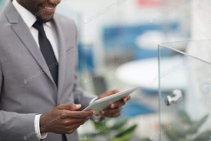African Businessman Holding Digital Tablet