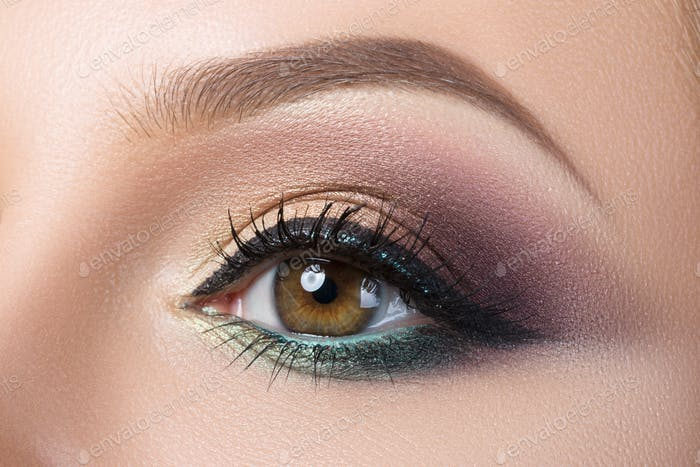 Close-up of woman's eye with creative modern make-up