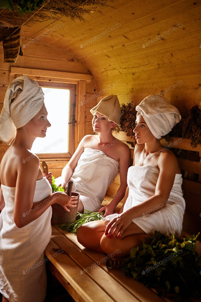 three girls relaxing in sauna
