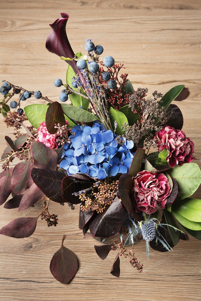 Beautiful autumn bouquet background, dried meadow flowers and leaves