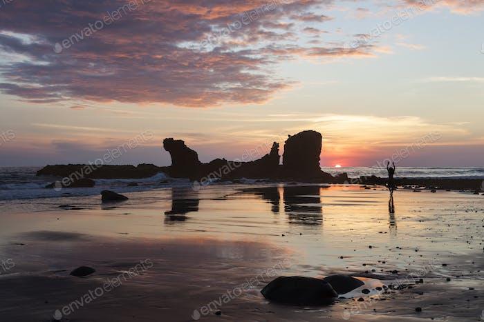 Rocks on El Tunco Beach at sunset