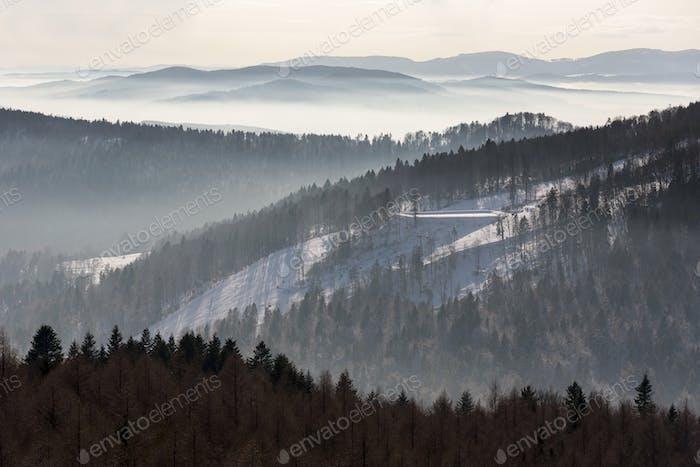 Foggy view of Beskid Sadecki mountain range in Poland