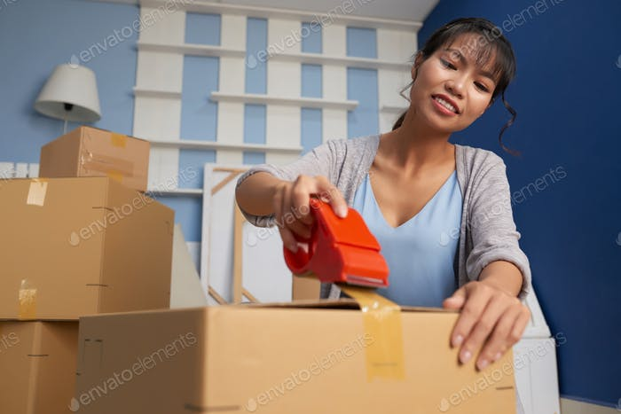 Woman Sealing Moving Box
