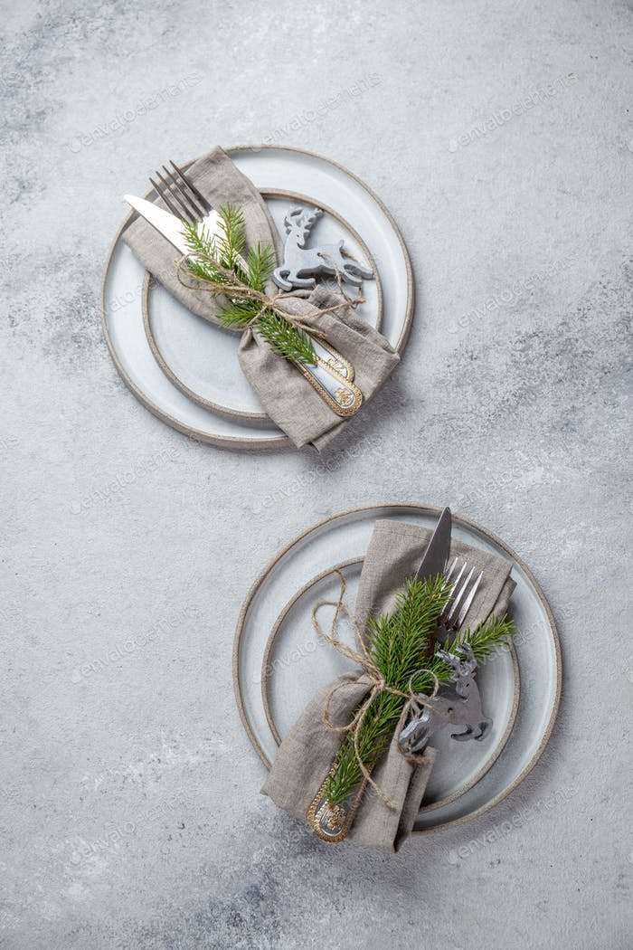 Christmas table cutlery set with holiday decoration. Top view, copy space.