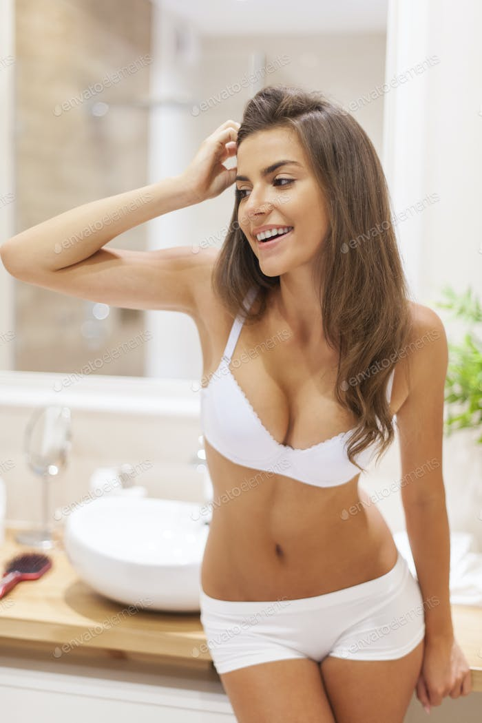 Morning portrait of beautiful woman in bathroom