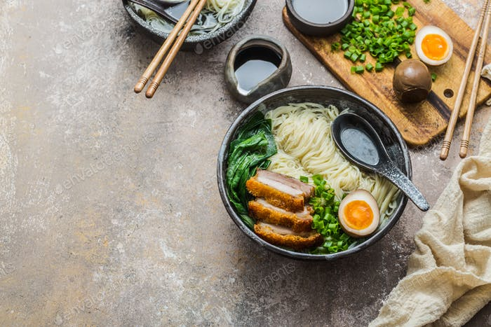 Japanese ramen soup with egg, pork and onion, copy space