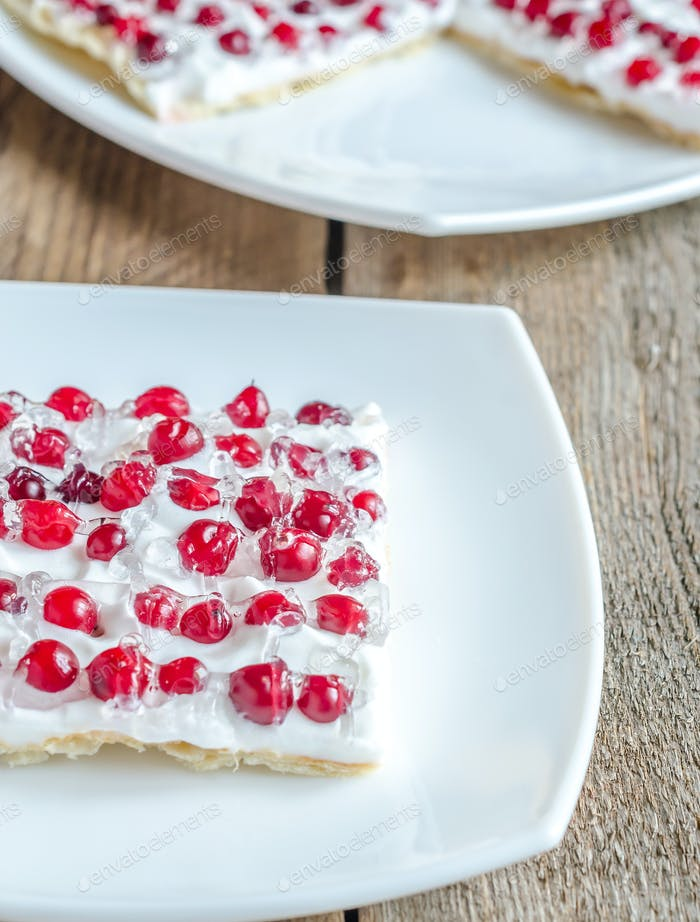 Tart with whipped cream and fresh cranberries