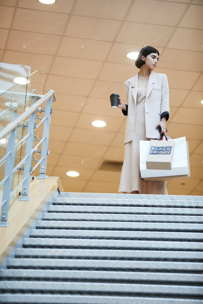 Elegant Woman Shopping in Mall