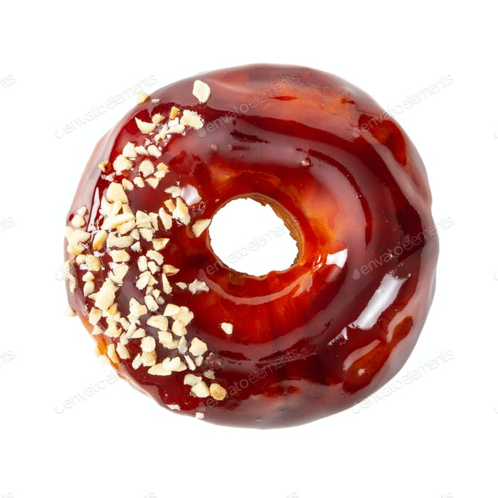 Donut with glossy mirror caramel glaze isolated on white