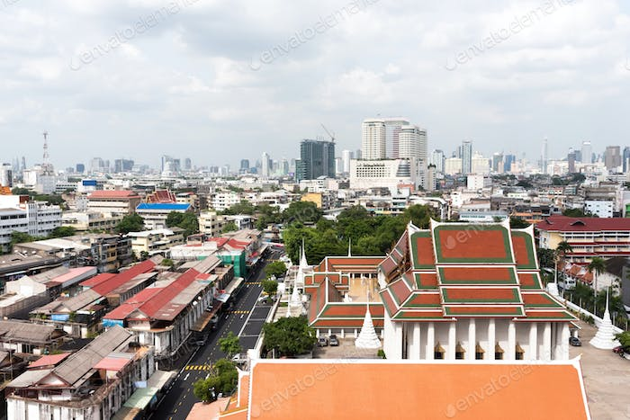 Aerial view of cityscape of Bangkok under cloudy sky