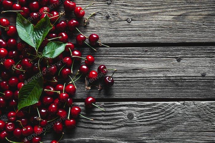 fresh cherries on wooden table, healthy food, fruit