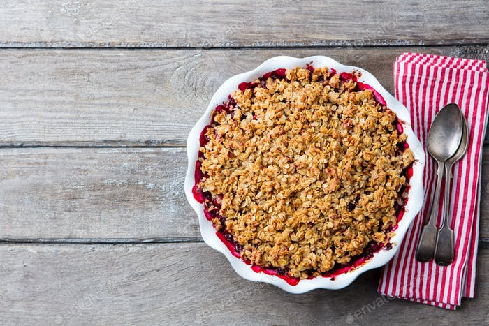 Thumbnail for Berry Crumble in White Baking Dish on Grey Wooden Background. Top View. Copy Space