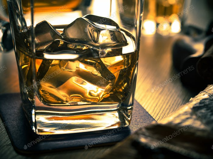 Whiskey on the rocks on a wooden table