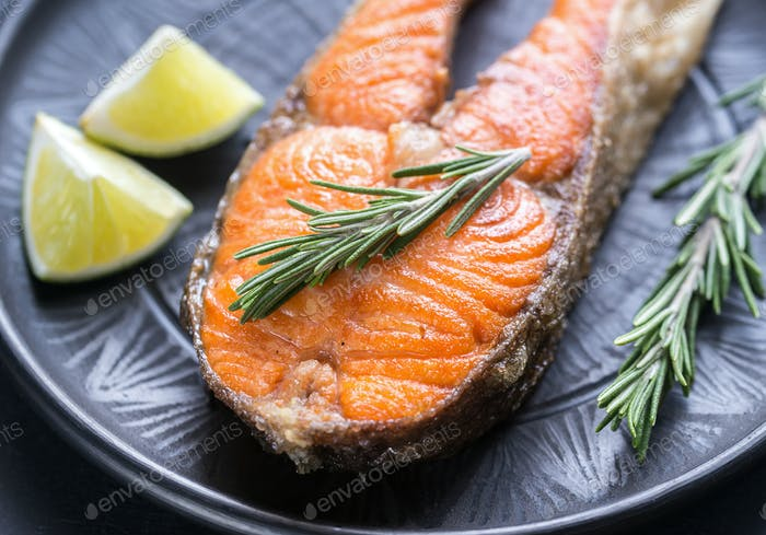 Roasted trout steak with fresh rosemary
